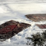 Rug Beating in the Snow